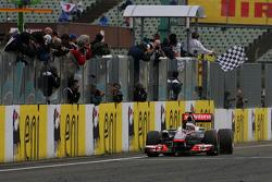 Jenson Button, McLaren Mercedes takes the checkered flag