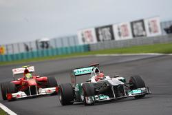 Michael Schumacher, Mercedes GP F1 Team leads Felipe Massa, Scuderia Ferrari