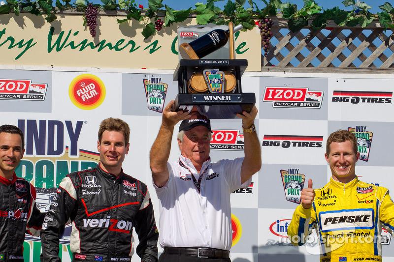 Podium: race winner Will Power, Team Penske, second place Helio Castroneves, Team Penske, third place Ryan Briscoe, Team Penske with Roger Penske