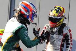 Valtteri Bottas celebrates winning the race and the drivers championship in parc ferme with Rio Haryanto