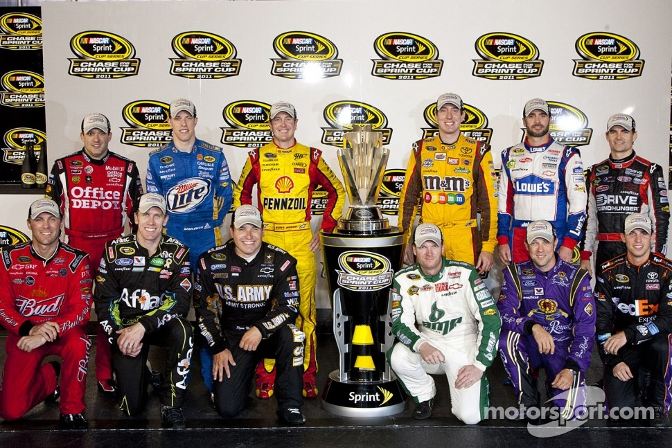 Tony Stewart, Brad Keselowski, Kurt Busch, Kyle Busch, Jimmie Johnson, Jeff Gordon, Kevin Harvick, Carl Edwards, Ryan Newman, Dale Earnhardt Jr., Matt Kenseth and Denny Hamlin pose after clinching spots in the Chase for the NASCAR Sprint Cup