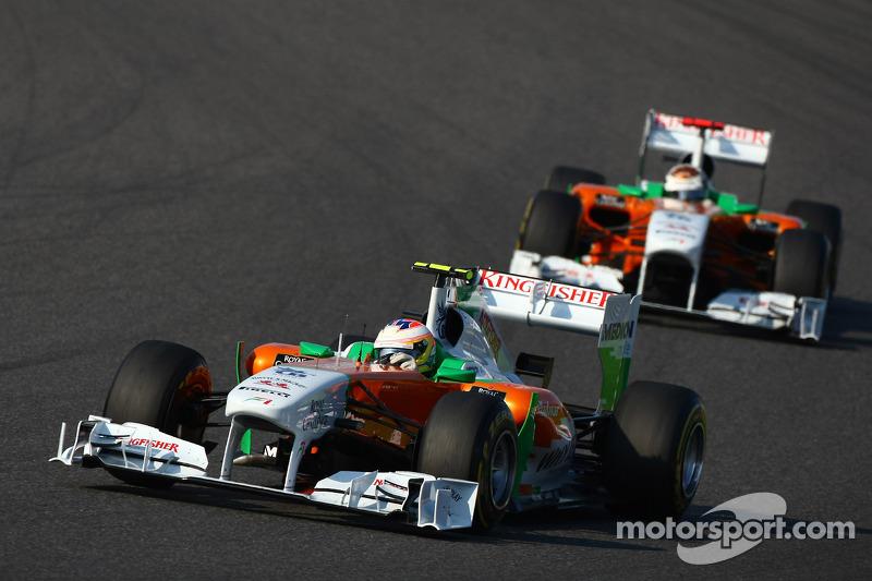 Paul di Resta, Force India F1 Team leads Adrian Sutil, Force India F1 Team