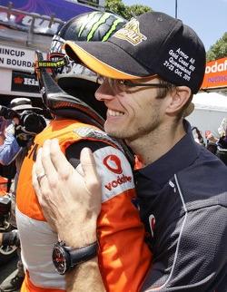 Jamie Whincup and Sébastien Bourdais celebrate pole