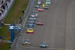 Carl Edwards, Roush Fenway Racing Ford and Martin Truex Jr., Michael Waltrip Racing Toyota lead the field