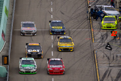 Kyle Busch, Joe Gibbs Racing Toyota and Landon Cassill, Chevrolet battle on pit road