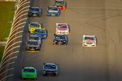 Danica Patrick, JR Motorsport Chevrolet and Jason Leffler, Turner Motorsport Chevrolet lead a group of cars