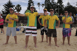 Matthew White from Channel Seven, former test cricketer Mark Waugh, Will Davison, Lee Holdsworth and Michael Caruso react as they lose their beach cricket match against the New Zealand side
