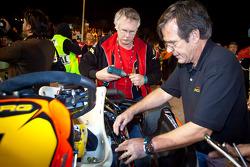 Jan Heylen's team work on his kart on the starting grid