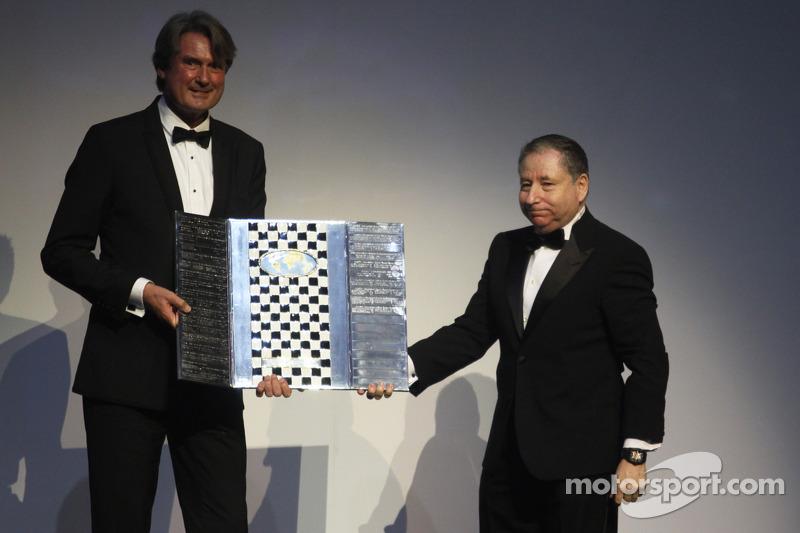 FIA President Jean Todt presents a Formula One Promotional Trophy