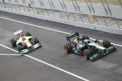 Vitaly Petrov, Caterham F1 Team leads Nico Hulkenberg, Sahara Force India Formula One Team