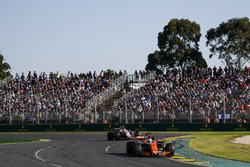Fernando Alonso, McLaren MCL32, leads Esteban Ocon, Force India VJM10