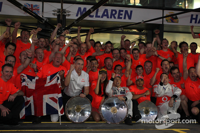 The McLaren team celebrate Jenson Button, McLaren Mercedes win, with John Button, Martin Whitmarsh, McLaren, Chief Executive Officer, Jessica Michibata, McLaren Mercedes