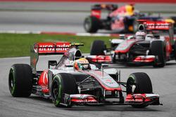 Lewis Hamilton, McLaren leads Jenson Button, McLaren and Sebastian Vettel, Red Bull Racing