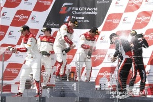 Podium: race winners Stéphane Ortelli, Laurens Vanthoor, second place Frank Stippler, Oliver Jarvis, third place Markus Winkelhock and Marc Basseng