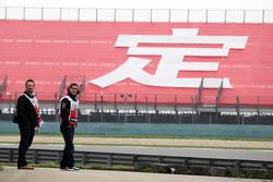 Sebastien Buemi, Red Bull Racing and Scuderia Toro Rosso Reserve Driver watches trackside