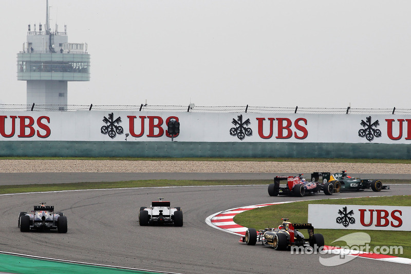 Kimi Raikkonen, Lotus volgt Mark Webber, Red Bull Racing en Jenson Button, McLaren