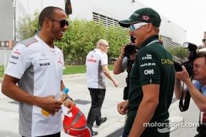 Lewis Hamilton, McLaren with Heikki Kovalainen, Caterham