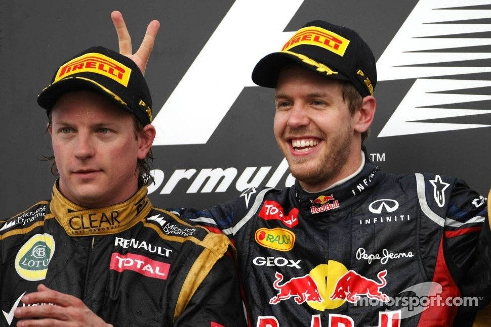 Kimi Raikkonen, Lotus F1 Team and Sebastian Vettel, Red Bull Racing