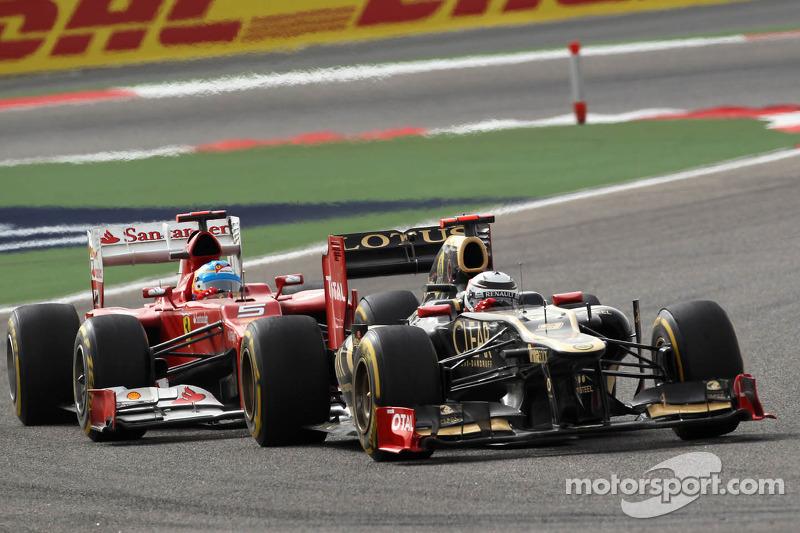 Kimi Raikkonen, Lotus Renault F1 Team voor Fernando Alonso, Scuderia Ferrari