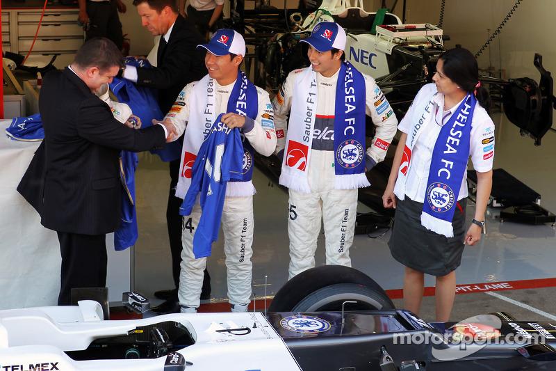 Ron Gouray, Chelsea Football Club CEO; Kamui Kobayashi, Sauber F1 Team; Sergio Perez, Sauber F1 Team