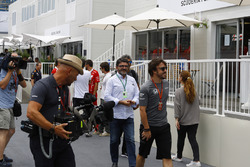Fernando Alonso, McLaren, is filmed walking through the paddock ahead of his manager Luis Garcia Abad
