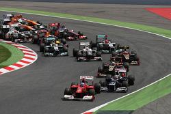 Fernando Alonso, Scuderia Ferrari leads pole sitter Pastor Maldonado, Williams at the start of the race