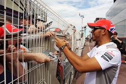 Lewis Hamilton, McLaren Mercedes signs autographs for the fans