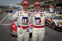 GT500 winners Takashi Kogure and Carlo Van Dam celebrate