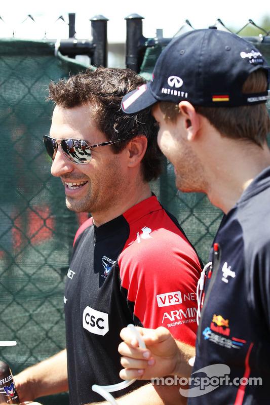 Timo Glock, Marussia F1 Team and Sebastian Vettel, Red Bull Racing