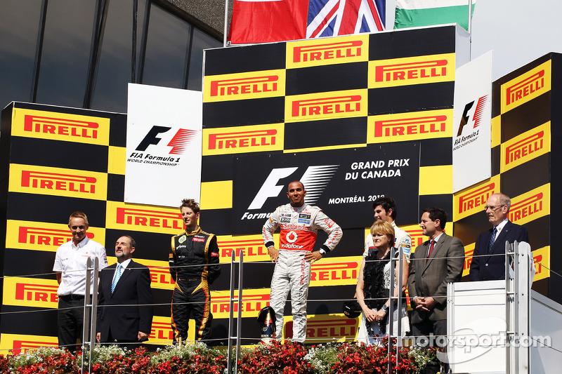 The podium, Romain Grosjean, Lotus F1 Team, second; Lewis Hamilton, McLaren Mercedes, race winner; Sergio Perez, Sauber, third