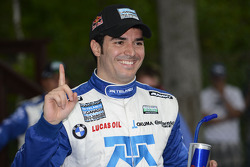 Victory lane: Memo Rojas celebrates the win