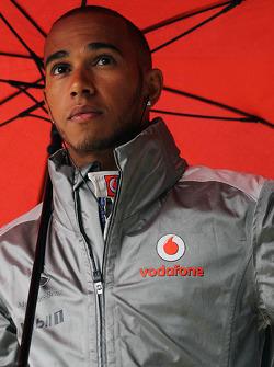 Lewis Hamilton, McLaren under an umbrella