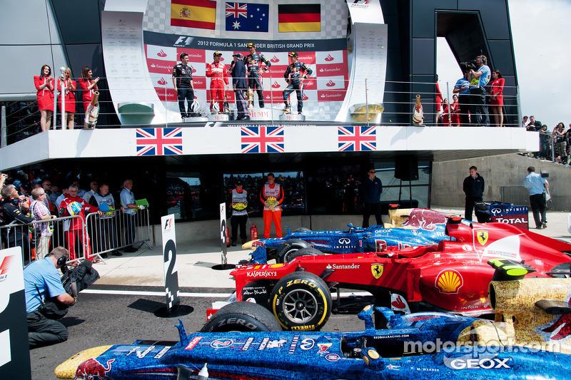 The podium, Fernando Alonso, Ferrari, second; Mark Webber, Red Bull Racing, race winner; Sebastian Vettel, Red Bull Racing, third.
