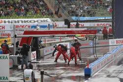 The pit crew of  Mattias Ekström, ABT Sportsline Audi A5 DTM  cleans the pit stall