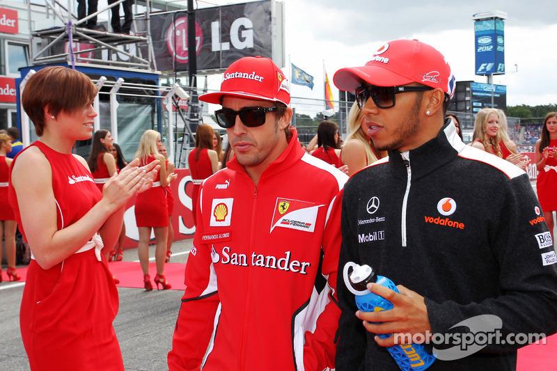 Fernando Alonso, Ferrari with Lewis Hamilton, McLaren on the drivers parade