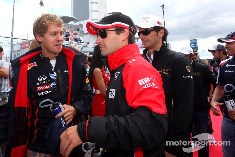 Sebastian Vettel, Red Bull Racing en Timo Glock, Marussia F1 Team