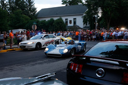 Race cars leave Elkhart Lake after the Friday Concours.  #11 1965 Lola T70 MkI : Marc Devis