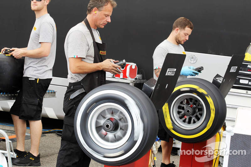 Pirelli engineers work on the tyres