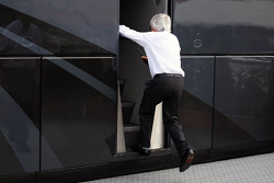 Bernie Ecclestone, CEO Formula One Group, heads into his motorhome