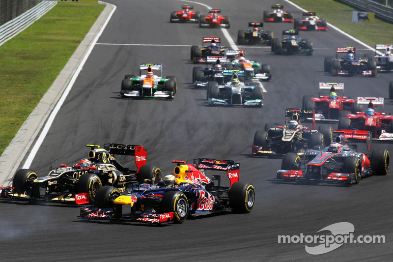 Romain Grosjean, Lotus F1 en Sebastian Vettel, Red Bull Racing duel
