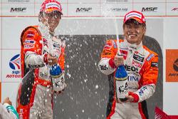 GT500 podium; winners Daisuke Ito and Kazuya Oshima
