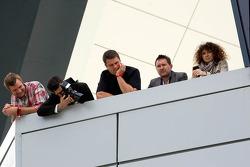 Spectators watch the podium