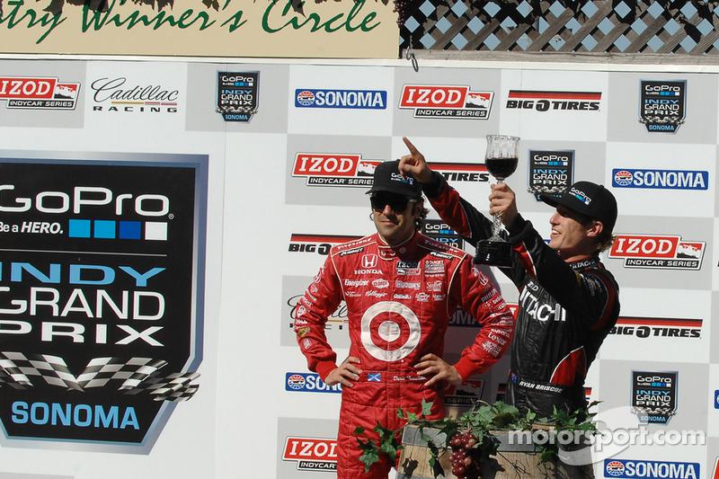 Victory lane: race winner Ryan Briscoe, third place Dario Franchitti