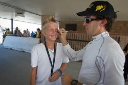 Esteban Guerrieri, Sam Schmidt Motorsports signs the face of a young fan