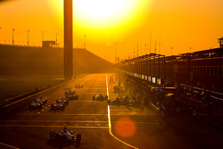 Pit stop action at dusk