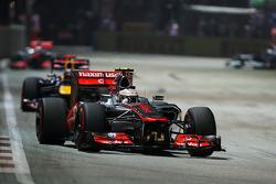 Lewis Hamilton, McLaren leads Sebastian Vettel, Red Bull Racing