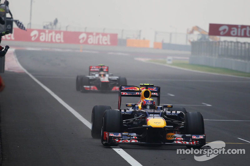 Mark Webber, Red Bull Racing takes the chequered flag at the end of the race