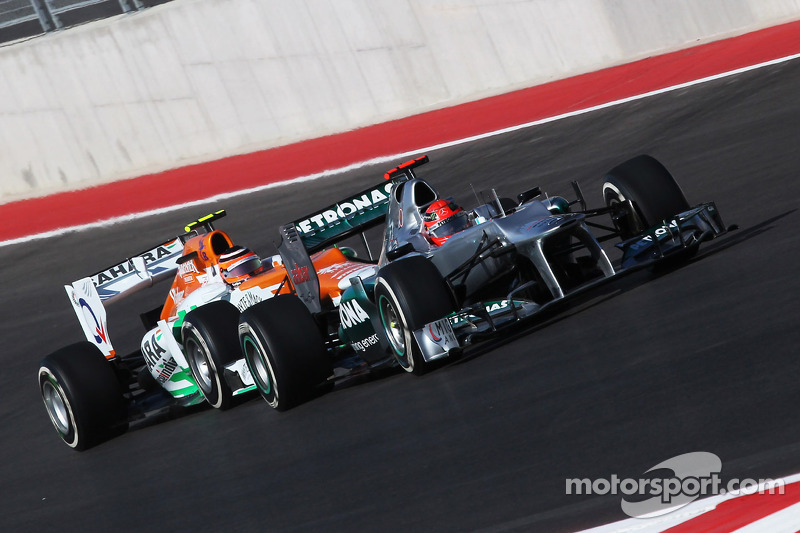 Michael Schumacher, Mercedes AMG F1 W03 leads Nico Hulkenberg, Sahara Force India F1 VJM05