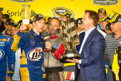 Championship victory lane: 2012 NASCAR Sprint Cup Series champion Brad Keselowski, Penske Racing Dodge accepts the Sprint Cup