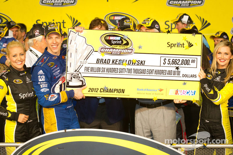 Championship victory lane: 2012 NASCAR Sprint Cup Series champion Brad Keselowski, Penske Racing Dodge accepts the championship check